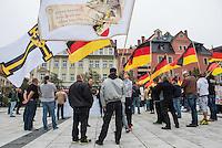 """Rechte demonstrieren in Bautzen gegen Fluechtlinge.<br /> Am Sonntag den 18. September 2016 versammelten sich im saechsischen Bautzen ca. 120 Rechte zu einem Kundgebung mit anschliessender Demonstration um gegen Fluechtlinge zu demonstrieren. Sie riefen Parolen gegen Fluechtlinge und gegen Angela Merkel und beschimpften Medienvertreter als """"Volksverraeter"""".<br /> Nach Aussagen von Anwohnern waren nur etwa 15 Teilnehmer aus Bautzen. Bautzener Rechtsextreme hatten zuvor aufgerufen, sich vorerst nicht an Demonstrationen zu beteiligen, bis ein von ihnen an die Stadtverwaltung gestelltes Ultimatum, zu Loesung der Fluechtlingsfrage verstrichen ist.<br /> Im Bild: Ein Rechter traegt eine Fahne auf der ein Adler mit Schwert und schwarz-weiss-rotem Schild und dem Spruch """"Fest und trotzig wie die Eichen, woll'n wir steh'n und nimmer weichen"""".<br /> 18.9.2016, Bautzen/Sachsen<br /> Copyright: Christian-Ditsch.de<br /> [Inhaltsveraendernde Manipulation des Fotos nur nach ausdruecklicher Genehmigung des Fotografen. Vereinbarungen ueber Abtretung von Persoenlichkeitsrechten/Model Release der abgebildeten Person/Personen liegen nicht vor. NO MODEL RELEASE! Nur fuer Redaktionelle Zwecke. Don't publish without copyright Christian-Ditsch.de, Veroeffentlichung nur mit Fotografennennung, sowie gegen Honorar, MwSt. und Beleg. Konto: I N G - D i B a, IBAN DE58500105175400192269, BIC INGDDEFFXXX, Kontakt: post@christian-ditsch.de<br /> Bei der Bearbeitung der Dateiinformationen darf die Urheberkennzeichnung in den EXIF- und  IPTC-Daten nicht entfernt werden, diese sind in digitalen Medien nach §95c UrhG rechtlich geschuetzt. Der Urhebervermerk wird gemaess §13 UrhG verlangt.]"""