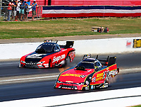 May 6, 2018; Commerce, GA, USA; NHRA funny car driver Courtney Force (near) races alongside Cruz Pedregon during the Southern Nationals at Atlanta Dragway. Mandatory Credit: Mark J. Rebilas-USA TODAY Sports