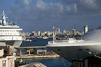 AJ2328, cruise ship, Puerto Rico, San Juan, Caribbean, Porto Rico, Caribbean Islands, Cruise ships docked in the harbor of San Juan in Puerto Rico. Skyline of the city in the distance.