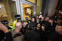 Class War stage a 'Poor Door' protest at 1 Commercial street in East London. 18-10-14 The protest called Iam Bone and Class War was against social segregation where social housing tenants have to use a side entrance to the building.