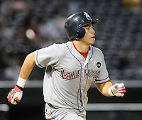 Sept. 17, 2009: Catcher Travis d'Arnaud (5) of the Lakewood BlueClaws runs out a fly ball in Game 3 of the South Atlantic League Championship Series between the Greenville Drive and the BlueClaws Sept. 17, 2009, at Fluor Field at the West End in Greenville, S.C.  Photo by: Tom Priddy/Four Seam Images