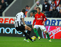 Saturday 17 November 2012<br /> Pictured: Pablo Hernandez of Swansea (R) against Danny Simpson of Newcastle (L). <br /> Re: Barclay's Premier League, Newcastle United v Swansea City FC at St James' Park, Newcastle Upon Tyne, UK.