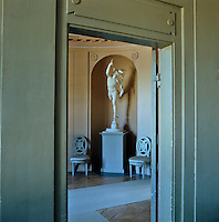 View into the Oval Vestibule with a statue that is a copy of the famous Mercury by Giambologna