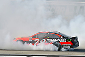 2017 Monster Energy NASCAR Cup Series - Kobalt 400<br /> Las Vegas Motor Speedway - Las Vegas, NV USA<br /> Sunday 12 March 2017<br /> Martin Truex Jr, Bass Pro Shops/TRACKER BOATS Toyota Camry celebrates his win with a burnout<br /> World Copyright: Nigel Kinrade/LAT Images<br /> ref: Digital Image 17LAS1nk07776