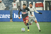 FOXBOROUGH, MA - NOVEMBER 1: Carles Gil #22 of New England Revolution with Junior Moreno #5 of DC United in pursuit during a game between D.C. United and New England Revolution at Gillette Stadium on November 1, 2020 in Foxborough, Massachusetts.