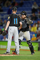 Akron RubberDucks catcher Eric Haase (13) embraces relief pitcher Robbie Aviles (11) after closing out a game against the Binghamton Rumble Ponies on May 12, 2017 at NYSEG Stadium in Binghamton, New York.  Akron defeated Binghamton 5-1.  (Mike Janes/Four Seam Images)