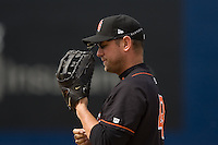 June 8, 2008: Fresno Grizzlies' Scott McClain lubes up his glove during a Pacific Coast League game against the Tacoma Rainiers at Cheney Stadium in Tacoma, Washington.