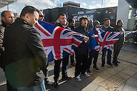 """EDL protest and counter demonstration Slough, England 1-2-14 The far right English Defence League holds a national protest in Slough. Between 150-200 EDL supporters marched under heavy Police protection. A much larger counter demostration called by Unite Against Fascism, Slough Trades Council and ANTIFA  was attended by a large contingent of local youth and blocked the route of the EDL march and scuffled with Police. Some local Pakistani men get close to the EDL protest and and chant """"St George was an Arab"""" at the EDL supporters."""