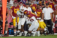 LOS ANGELES, CA - SEPTEMBER 11: Noah Williams #9 of the Stanford Cardinal tackles Vavae Malepeai #6 of the USC Trojans during a game between University of Southern California and Stanford Football at Los Angeles Memorial Coliseum on September 11, 2021 in Los Angeles, California.
