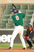 Chase Austin #8 of the Greensboro Grasshoppers at bat against the Kannapolis Intimidators at Fieldcrest Cannon Stadium August 2, 2010, in Kannapolis, North Carolina.  Photo by Brian Westerholt / Four Seam Images