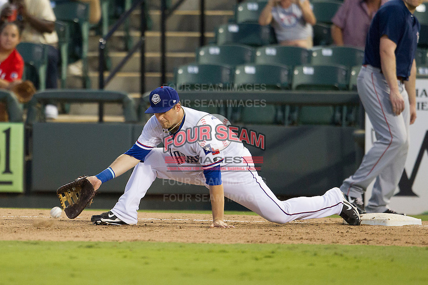 Round Rock Express first baseman Chris McGuiness (21) stretches for a throw against the Oklahoma City RedHawks during the Pacific Coast League baseball game on August 25, 2013 at the Dell Diamond in Round Rock, Texas. Round Rock defeated Oklahoma City 9-2. (Andrew Woolley/Four Seam Images)