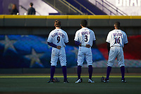 (L-R) Winston-Salem Dash outfielders Blake Rutherford (9), Joel Booker (3), and Luis Alexander Basabe (16) stand for the National Anthem prior to the game against the Salem Red Sox at BB&T Ballpark on April 20, 2018 in Winston-Salem, North Carolina.  The Red Sox defeated the Dash 10-3.  (Brian Westerholt/Four Seam Images)