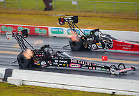 Sep 27, 2020; Gainesville, Florida, USA; NHRA top fuel driver Steve Torrence (near) in his Don Garlits themed dragster alongside Leah Pruett during the Gatornationals at Gainesville Raceway. Mandatory Credit: Mark J. Rebilas-USA TODAY Sports