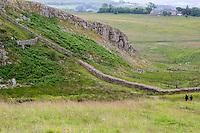 Northumberland,  England, UK.  Walking toward Peel Crags from Steel Rigg, Hadrian's Wall Footpath.