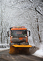 21/01/15<br /> <br /> A snow plough makes its way through snow-laden trees near Bakewell, Derbyshire.<br /> <br /> More than 20 schools in Derbyshire were closed today following overnight snowfall that continued into the morning across the Peak District.<br /> <br /> All Rights Reserved - F Stop Press.  www.fstoppress.com. Tel: +44 (0)1335 300098