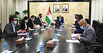 Palestinian Prime Minister Mohammad Ishtayeh, chairs a meeting in the presence of the European Union representative to Palestine, Sven Burgsdorf, and by video link, the head of the Qatar's Ambassador to the Palestinian Authority, Mohammed Al Emadi, in the West Bank city of Ramallah, on February 24, 2021. Photo by Prime Minister Office
