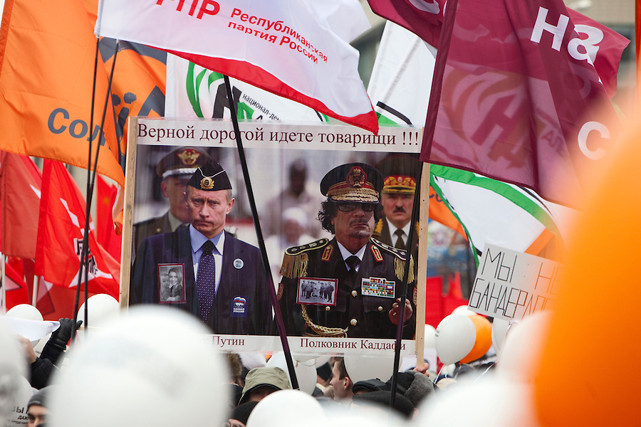 Moscow, Russia, 24/12/2011..A placard comparing dead Libyan leader Gaddafi and Vladimir Putin. An estimated crowd of up to 100,000 gather for a protest against election fraud and Prime Minister Vladimir Putin in the largest anti-government demonstration in Russia since the collapse of the Soviet Union.