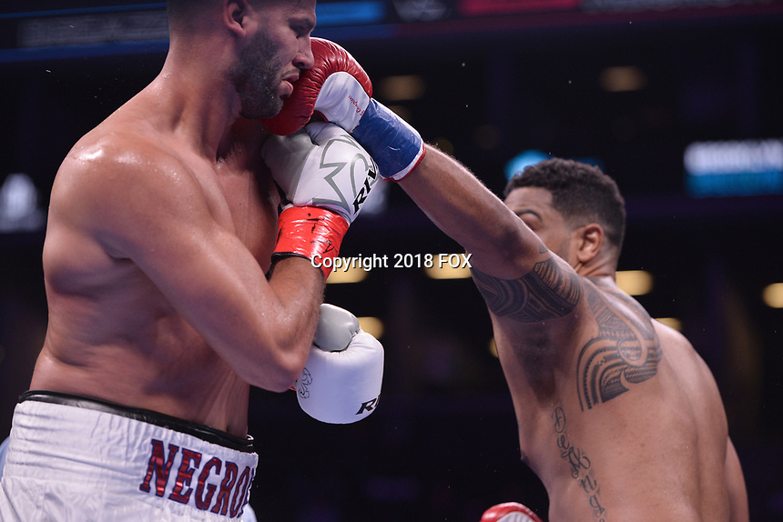 """BROOKLYN, NY - DECEMBER 22: (L-R) Boxers Carlos Negron takes a punch from Dominic Breazeale during their Heavyweight match at the Fox Sports and Premier Boxing Champions  December 22 """"PBC on Fox"""" Fight Night at the Barclays Center on December 22, 2018 in Brooklyn, New York. (Photo by Anthony Behar/Fox Sports/PictureGroup)"""
