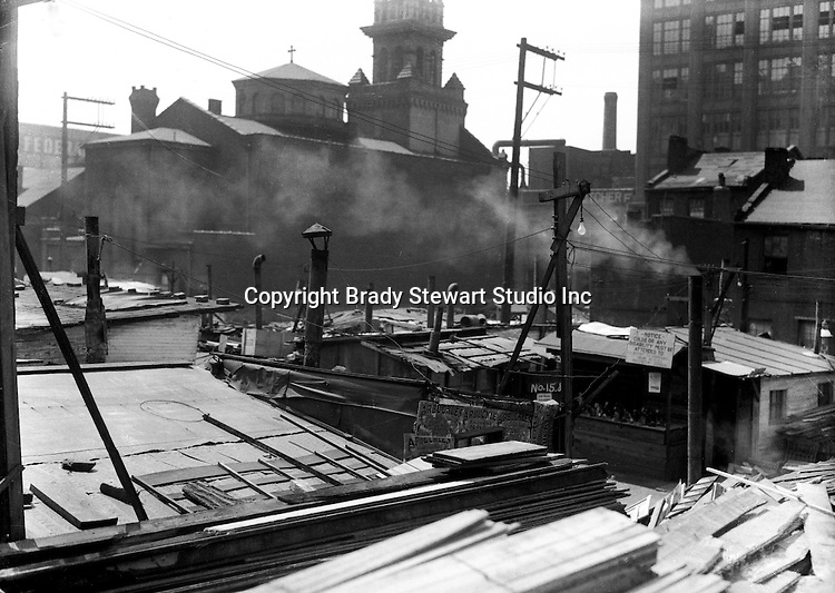 Pittsburgh PA:  Pittsburgh's Shantytown near St Elisabeth's church.  During the depression, the area from the PA RR Station to the 17th street bridge was called Shantytown.  Father Cox, a local priest, helped the residents through food kitchens and highlighting their plight.  Brady Stewart photographed the area for the City of Pittsburgh.