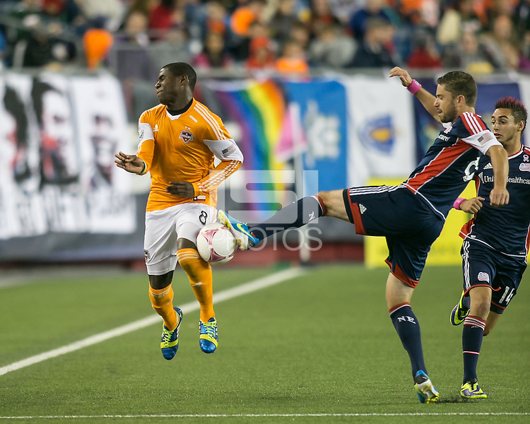 Houston Dynamo defender Kofi Sarkodie (8) blocks a kick downfield by New England Revolution defender Chris Tierney (8).  The New England Revolution played to a 1-1 draw against the Houston Dynamo during a Major League Soccer (MLS) match at Gillette Stadium in Foxborough, MA on September 28, 2013.