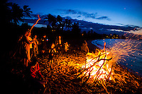 Family and friends having a bonfire on the beach, North Shore, O'ahu