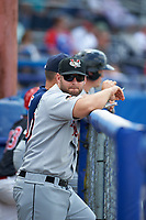 Tri-City ValleyCats coach Jeremy Barnes (20) in the dugout during a game against the Batavia Muckdogs on July 16, 2017 at Dwyer Stadium in Batavia, New York.  Tri-City defeated Batavia 13-8.  (Mike Janes/Four Seam Images)