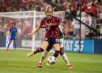 AUSTIN, TX - JUNE 16: Kristie Mewis #22 of the USWNT fights for the ball with Glory Ogbonna #4 of Nigeria during a game between Nigeria and USWNT at Q2 Stadium on June 16, 2021 in Austin, Texas.