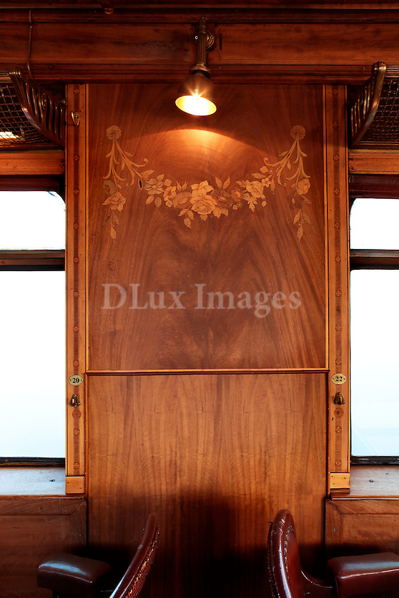 carved wood panel on train wagon