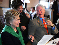 Sen. Hillary Clinton and former President Bill Clinton share a laugh with waitress Dawny Valdez while ordering lunch at the Latin King restaurant in Des Moines, Iowa during the Iowa caucuses on January 3, 2008.