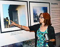 Carmen Taylor of Fort Smith describes what she first saw (sparks from a fire) at the World Trade Center before capturing this image just as the second plane approched the building on Sept. 11, 2001. Taylor was at the U.S. Marshals Museum were a 911 display is set up in Fort Smith.  (Special to NWA Democrat Gazette/Brian Sanderford)