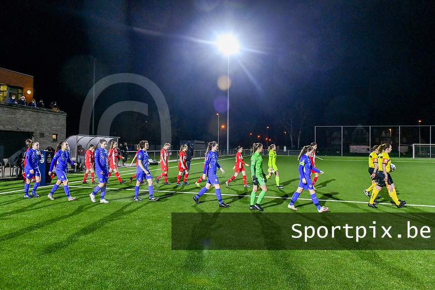 referees and players entering the field before a female soccer game between  Racing Genk Ladies and Standard Femina on the 13 th matchday of the 2020 - 2021 season of Belgian Scooore Womens Super League , friday 5 th of february 2021  in Genk , Belgium . PHOTO SPORTPIX.BE | SPP | STIJN AUDOOREN