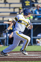 Michigan Wolverines first baseman Carmen Benedetti (43) follows through on his swing against the Central Michigan Chippewas on March 29, 2016 at Ray Fisher Stadium in Ann Arbor, Michigan. Michigan defeated Central Michigan 9-7. (Andrew Woolley/Four Seam Images)