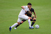 LOS ANGELES, CA - OCTOBER 25: Cristian Pavon #10 of the Los Angeles Galaxy moves with the ball during a game between Los Angeles Galaxy and Los Angeles FC at Banc of California Stadium on October 25, 2020 in Los Angeles, California.