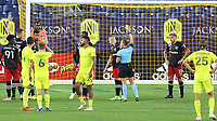 NASHVILLE, TN - SEPTEMBER 23: Referee Tori Penso shows the yellow card to Russell Canouse #4 of DC United during a game between D.C. United and Nashville SC at Nissan Stadium on September 23, 2020 in Nashville, Tennessee.