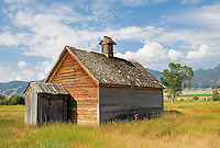 """""""MONTANA SCHOOL HOUSE""""<br /> <br /> 40 X 30 USD 3,500<br /> 36 X 24 USD 2,800<br /> <br /> 16 x 12.5 Paper print. Signed & numbered.<br /> 1/50 $95.00<br /> <br /> An old Montana schoolhouse sitting alone in a grassy field all but forgotten. The world famous Big Sky providing a spectacular background."""