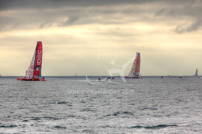 Idec and Sodebo at the start of the Route du Rhum La Banque Postale 2010..The Route du Rhum is a transatlantic single-handed yacht race, which takes places every 4 years in November. The course is between Saint Malo, Brittany, France and Pointe-à-Pitre, Guadeloupe.