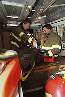 Firefighters from the Occidental Volunteer Fire Department remove an injured victim from a van during a training exercise Occidental California