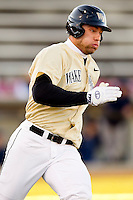 Mac Williamson #7 of the Wake Forest Demon Deacons hustles down the first base line against the Georgetown Hoyas at Wake Forest Baseball Park on February 26, 2012 in Winston-Salem, North Carolina.  (Brian Westerholt / Four Seam Images)