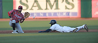 Northwest Arkansas Naturals' Dennicher Carrasco slides into second base ahead of the throw to Arkansas Travelers's Joe Rizzo Tuesday July 13, 2021 at Arvest Ballpark in Springdale. Visit nwaonline.com/21000714Daily/ and nwadg.com/photo. (NWA Democrat-Gazette/J.T. Wampler)