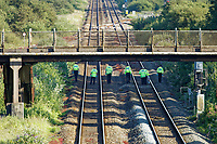 Pictured: Police officers are searching the tracks after the train which caused the accident is removed from near Margam in south Wales, UK. Wednesday 03 July 2019<br /> Re: Two rail workers have died after being hit by a passenger train between Port Talbot Parkway and Bridgend stations in south Wales, UK.<br /> The pair were struck near Margam by the Swansea to London Paddington train at about 10am.<br /> They were pronounced dead at the scene and a third person was treated for shock, but was not injured.