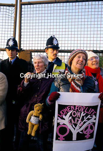 Greenham Women, singing, peacefully blockade of USAF nuclear cruise missile air base at Greenham Common Berkshire England 1983