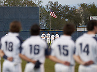 Calvary Christian Warriors Miles Curley (28), Landen Maroudis (12), Matt Rose (1), and Jackson Unice (17) stand for the national anthem before a game against the Lakeland Christian Vikings on February 27, 2021 at Calvary Christian High School in Clearwater, Florida.  (Mike Janes/Four Seam Images)