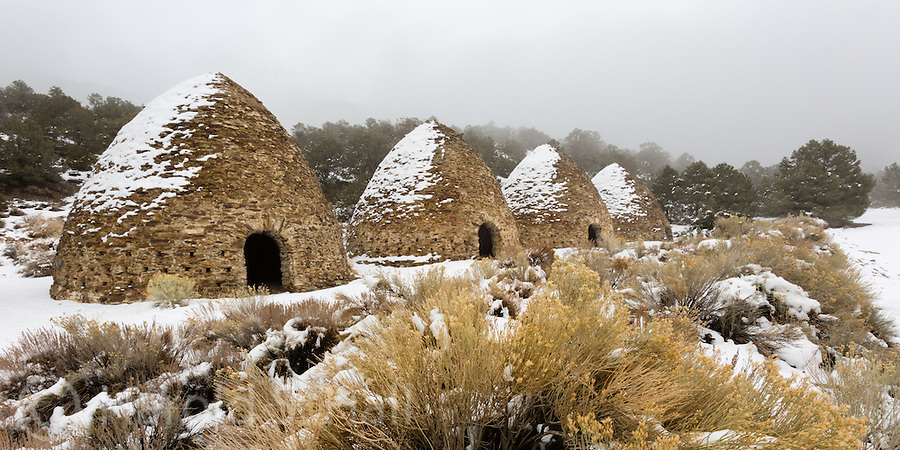 These are the charcoal kilns of Death Valley.  Built in 1877, they made charcoal from local wood for the mines to use in smelting.  A rare snowfall blankets the area as the clouds begin to clear, looking like smoke from these idle furnaces.