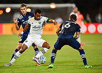 LAKE BUENA VISTA, FL - AUGUST 01: Jeremy Ebobisse #17 of the Portland Timbers protects the ball from James Sands #16 of New York City FC and Alexander Callens #6 of New York City FC during a game between Portland Timbers and New York City FC at ESPN Wide World of Sports on August 01, 2020 in Lake Buena Vista, Florida.
