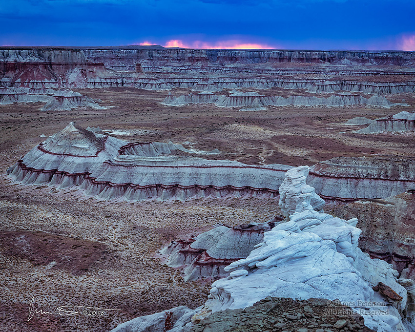 Dusk at Coal Mine Canyon ©2018 James D Peterson.  This was the scene just after a July sunset with a lingering monsoon thunderstorm in the distance.  This unusual canyon is in Northern Arizona, but it wouldn't be hard to believe that it's actually on Mars.