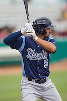 Corpus Christi Hooks second baseman Jio Mier (5) at bat during the Texas League baseball game against the San Antonio Missions on May 10, 2015 at Nelson Wolff Stadium in San Antonio, Texas. The Missions defeated the Hooks 6-5. (Andrew Woolley/Four Seam Images)