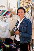 Cuba, Trinidad.  Vendor in Tourist Market Selling Che Guevara Caps.