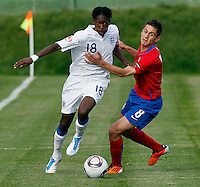 Blair Turgott (L) of England is challenged by Dejan Meleg of Serbia during the UEFA U-17 championship Group A match between Serbia and England on May 9, 2011 in Indjija, Serbia (Photo by Srdjan Stevanovic/Starsportphoto.com)