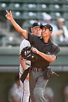 Rocket Wheeler (18), manager of the Rome Braves, is ejected by home plate umpire Harley Acosta after a close call on a rundown in Game 1 of a doubleheader against the Greenville Drive on Friday, August 3, 2018, at Fluor Field at the West End in Greenville, South Carolina. Rome won, 7-6. (Tom Priddy/Four Seam Images)