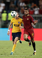 Football Soccer: UEFA Champions League AS Roma vs Atletico Madrid Stadio Olimpico Rome, Italy, September 12, 2017. <br /> Atletico Madrid's Filipe Luis (I) in action with Roma's Gregoire Defrel (r) during the Uefa Champions League football soccer match between AS Roma and Atletico Madrid at at Rome's Olympic stadium, September 12, 2017.<br /> UPDATE IMAGES PRESS/Isabella Bonotto